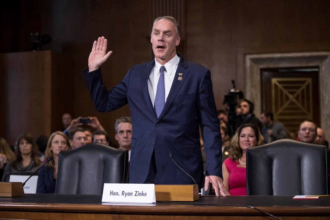 Interior Secretary-designate, Rep. Ryan Zinke, R-Mont., is sworn in on Capitol Hill in Washington, Jan. 17, prior to testifying at his confirmation hearing before the Senate Energy and Natural Resources Committee. (AP Photo/J. Scott Applewhite)