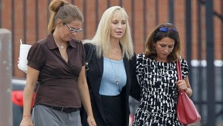 Karen Cunagin Sypher, center, smiles as she leaves the federal courthouse with two unidentified women in Louisville, Ky., Thursday, Aug. 5, 2010. (AP Photo/Ed Reinke)