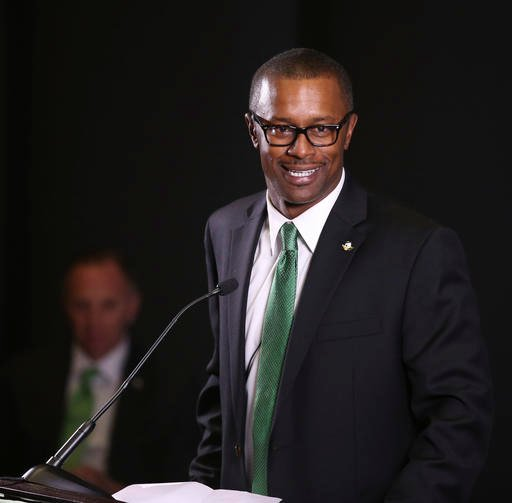 In this Dec. 8, 2016, file photo, new University of Oregon NCAA college football coach Willie Taggart takes questions during an introductory press conference in Eugene, Ore.