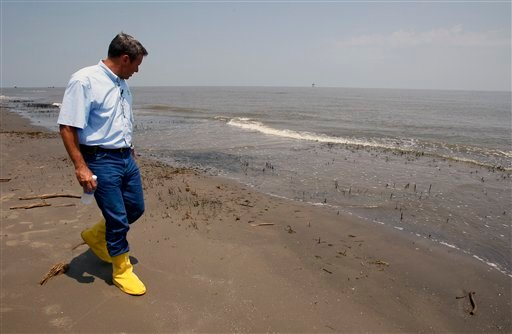 BP PLC COO of Exploration and Production Doug Suttles walks on a beach that workers have cleaned of oil near the South Pass of the Mississippi River in Plaquemines Parish, La.
