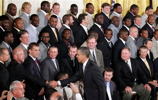 President Barack Obama greets members of New Orleans Saints football team during a ceremony honoring the 2009 NFL Super Bowl NFL Football Champions, Monday, Aug. 9, 2010, in the East Room of the White House in Washington. (AP Photo/Pablo Martinez Monsivai
