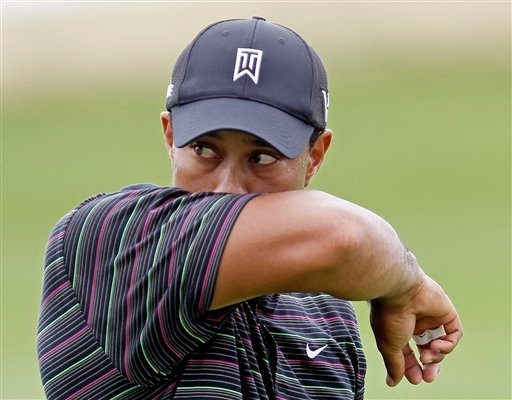 Tiger Woods wipes his face during a practice round for the PGA Championship golf tournament Monday, Aug. 9, 2010, at Whistling Straits in Haven, Wis. (AP Photo/Charlie Neibergall)