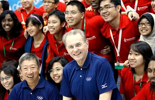 This is a Tuesday March 23, 2010 file photo of International Olympic Committee (IOC) President Jacques Rogge, center, and Vice President of the IOC, Ng Ser Miang, left, as they pose with youth ambassadors in Singapore.
