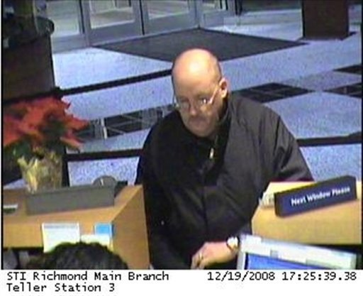 "In this Dec. 19, 2008 surveillance photo provided by the Federal Bureau of Investigation, a bank robber dubbed the ""Granddad Bandit,"" holds up a bank in Richmond, Va."