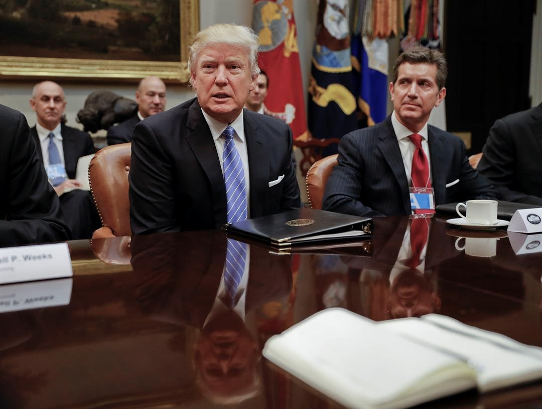 President Trump speaks while hosting a breakfast with business leaders in the Roosevelt Room of the White House Jan. 23, 2017. At left is Alex Gorsky, chairman and chief executive officer of Johnson & Johnson. (AP Photo/Pablo Martinez Monsivais)
