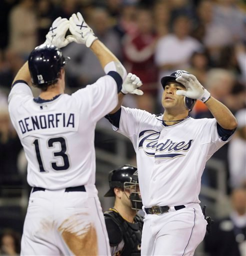San Diego Padres Jerry Hairston Jr, right is congratulated by teamate Chris Denorfia after hitting a two-run home run against the Pittsburgh Pirates in the sixth inning during their baseball game Wednesday, Aug. 11, 2010 in San Diego.