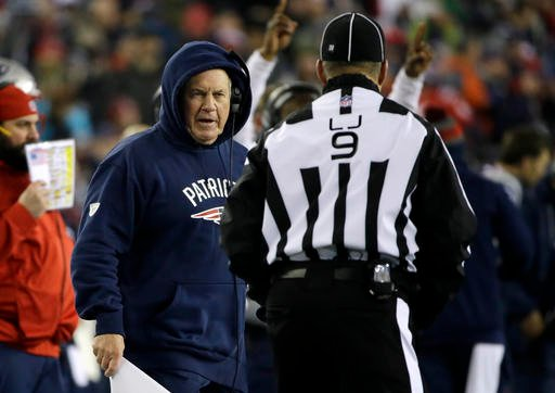 New England Patriots head coach Bill Belichick argues with line judge Mark Perlman (9) during the first half of the AFC championship NFL football game against the Pittsburgh Steelers, Sunday, Jan. 22, 2017, in Foxborough, Mass.