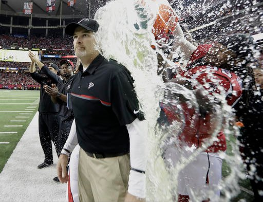 tlanta Falcons head coach Dan Quinn is dunked during the second half of the NFL football NFC championship game against the Green Bay Packers, Sunday, Jan. 22, 2017, in Atlanta.