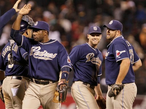 From left, San Diego Padres' Miguel Tejada, Chase Headley, and Heath Bell celebrate the 3-2 victory over the San Francisco Giants at the end of a baseball game Friday, Aug. 13, 2010, in San Francisco. (AP Photo/Ben Margot)