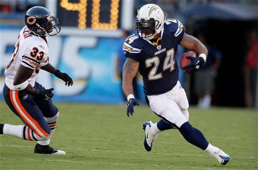 San Diego Chargers running back Ryan Mathews, right, runs up field as Chicago Bears' Charles Tillman defends during the first half of an NFL preseason football game Saturday, Aug. 14, 2010, in San Diego. (AP Photo/Gregory Bull)