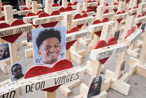A cross dedicated to Deon Virges is one of over 750 wooden crosses gathered on Michigan Avenue in Chicago on December 31, 2016 in memory of lives lost to violence in Chicago this year.