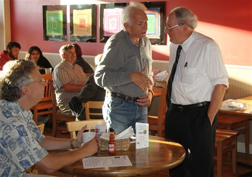 This photo provided by Big Rapids Pioneer shows Max Kantar, background left, and Ahlam Mohsen, second from left in background, before a question-and-answer session with U.S. Sen. Carl Levin, D-Mich., foreground right, at Pepper's Cafe and Deli.