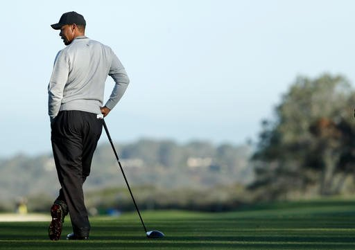 Tiger Woods waits after hitting his tee shot on the sixth hole of the north course during the Pro-Am event of the Farmers Insurance Open golf tournament Wednesday, Jan. 25, 2017, in San Diego.