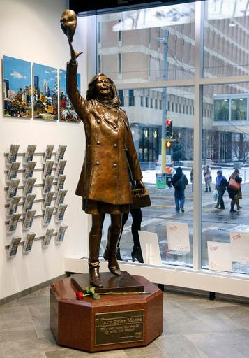 A single rose sits by the life-size bronze statue of Mary Tyler Moore at the Minneapolis Visitor Center, Wednesday, Jan. 25, 2017.