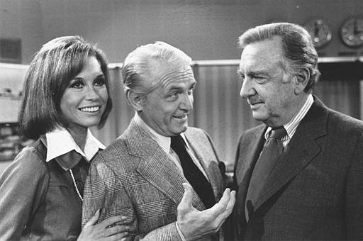 "TV news commentator Walter Cronkite, right, meets with actor Ted Baxter and actress Mary Tyler Moore as he makes an appearance at the ""Mary Tyler Moore Show,"" in Los Angeles, Calif., on February 4, 1974."