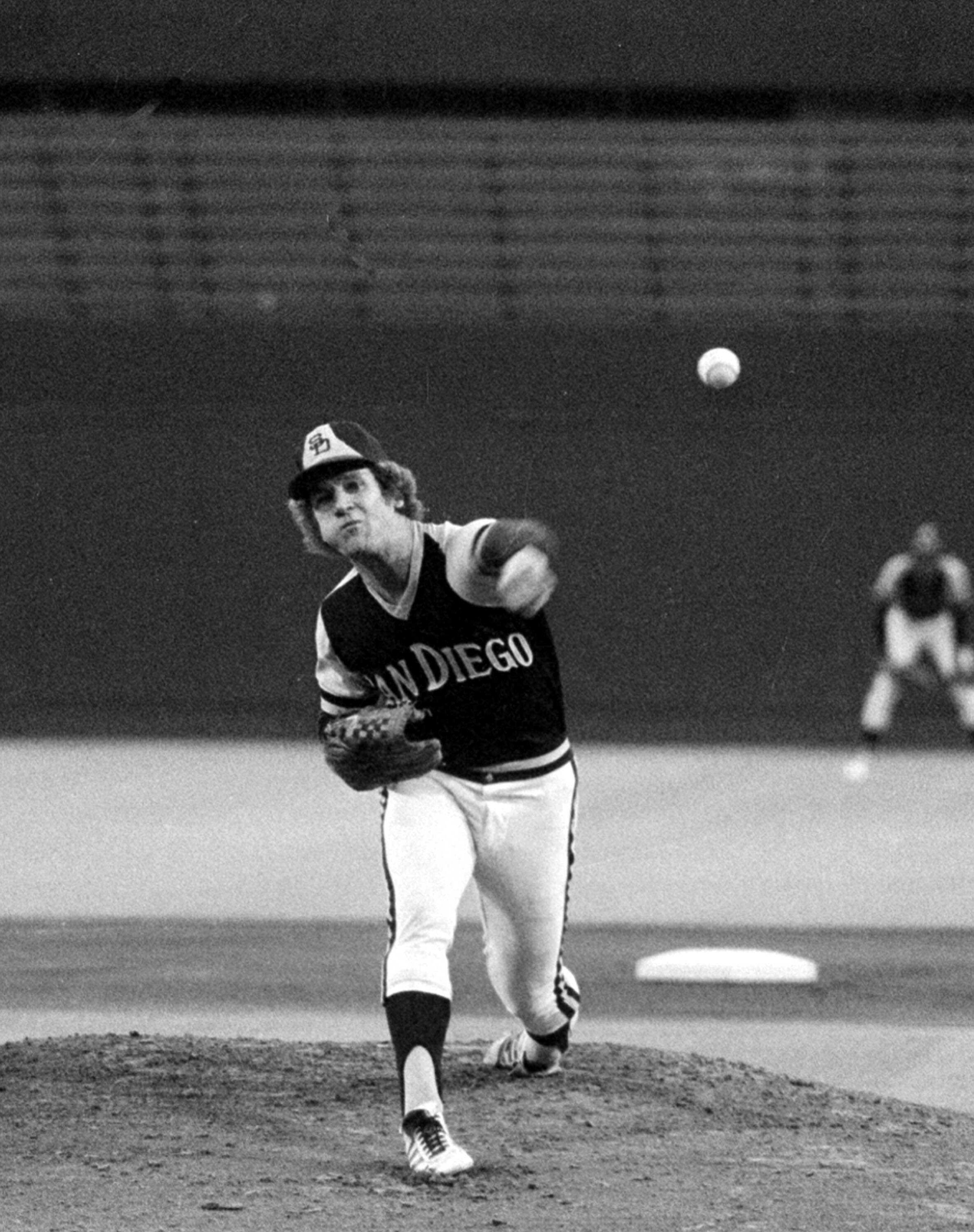 San Diego Padres pitcher Randy Jones, warms up Aug.18, 1976, for a night game at Busch Stadium in St. Louis. Jones has a 19-7 record and is hoping for number 20. (AP Photo/JAC)