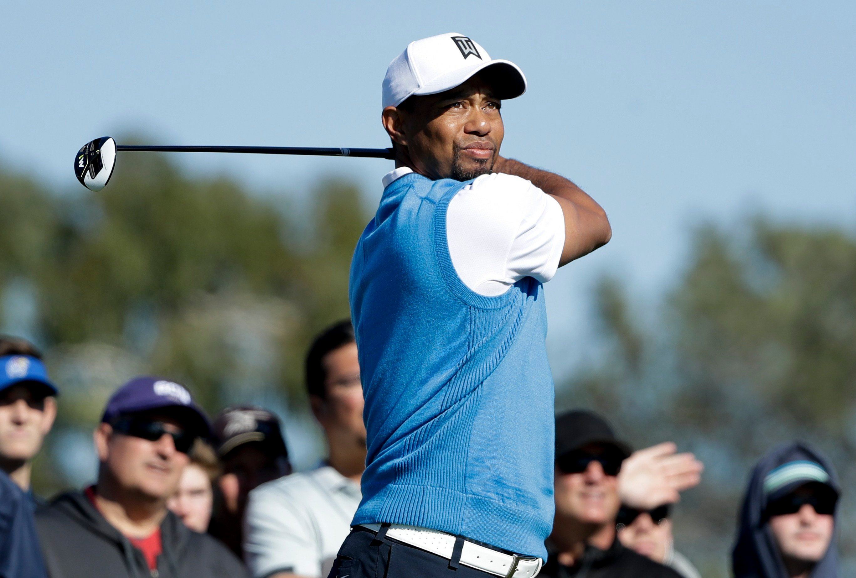 Tiger Woods watches his tee shot on the second hole of the south course during the first round of the Farmers Insurance Open golf tournament Thursday, Jan. 26, 2017, in San Diego. (AP Photo/Gregory Bull)