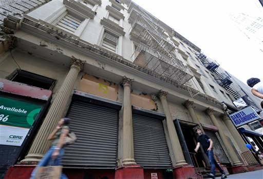 Pedestrians walk past the 19th century building on Park Place in Manhattan where Muslims plan to build a mosque and cultural center Saturday, Aug.14, 2010, in New York.