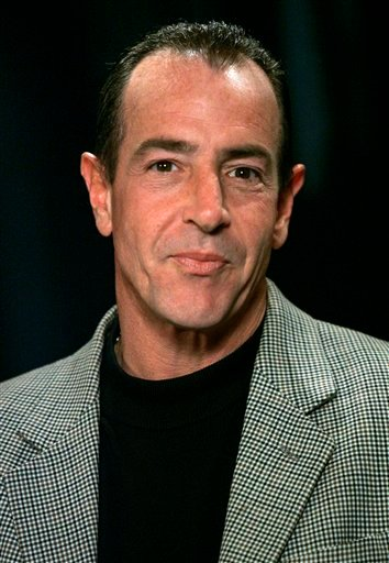 In this Oct. 24, 2007 file photo, Michael Lohan, father of actress Lindsay Lohan, is interviewed in New York. Lohan's ex-fiancee has told a New York judge she no longer wants to pursue criminal charges against him stemming from a fight last month.