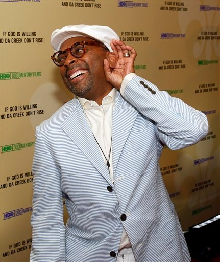"""Director Spike Lee laughs while standing on the red carpet at the premiere of his documentary """"If God Is Willing And Da Creek Don't Rise"""" in New Orleans, Tuesday, Aug. 17, 2010. The film is a follow-up to Lee's """"When The Levees Broke"""""""