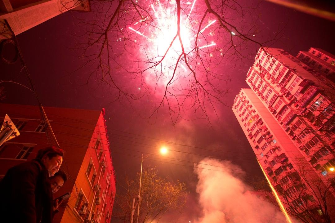 Residents set off fireworks on the eve of Lunar New Year in Beijing, China, Friday, Jan. 27, 2017. Chinese worldwide celebrate the Year of the Rooster on Jan 28, 2017 with family reunions and fireworks. (AP Photo/Ng Han Guan)