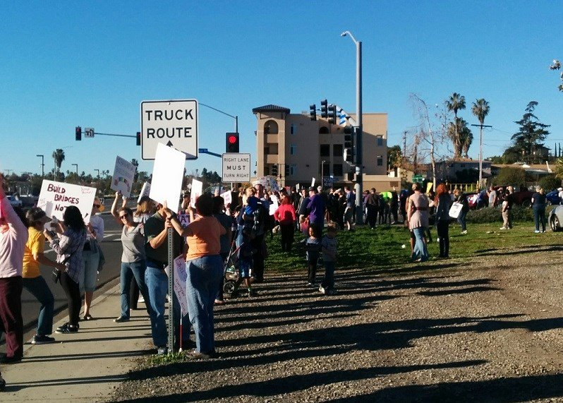 Protesters gathered Sunday on street corner in Vista with signs