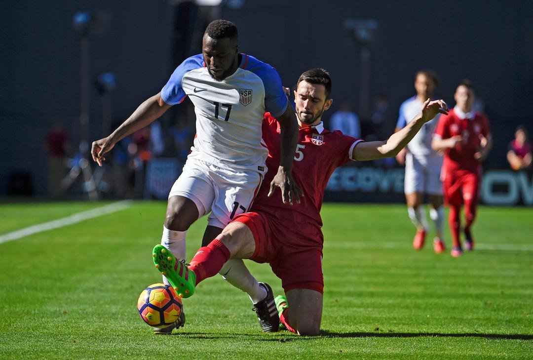United States' Jozy Altidore, left, fights for the ball with Serbia's Stephan Panic during a friendly soccer match Sunday, Jan. 29, 2017, in San Diego. (AP Photo/Denis Poroy)