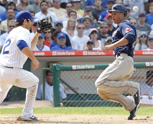 San Diego Padres' Will Venable, right, beats the throw at home plate from Chicago Cubs catcher Koyie Hill at third base to first baseman Xavier Nady during the seventh inning of a baseball game Thursday, Aug. 19, 2010 at Wrigley Field in Chicago. (AP Phot