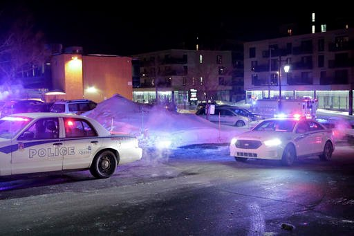 Police survey the scene after deadly shooting at a mosque in Quebec City, Canada, Sunday, Jan. 29, 2017. (Francis Vachon/The Canadian Press via AP)