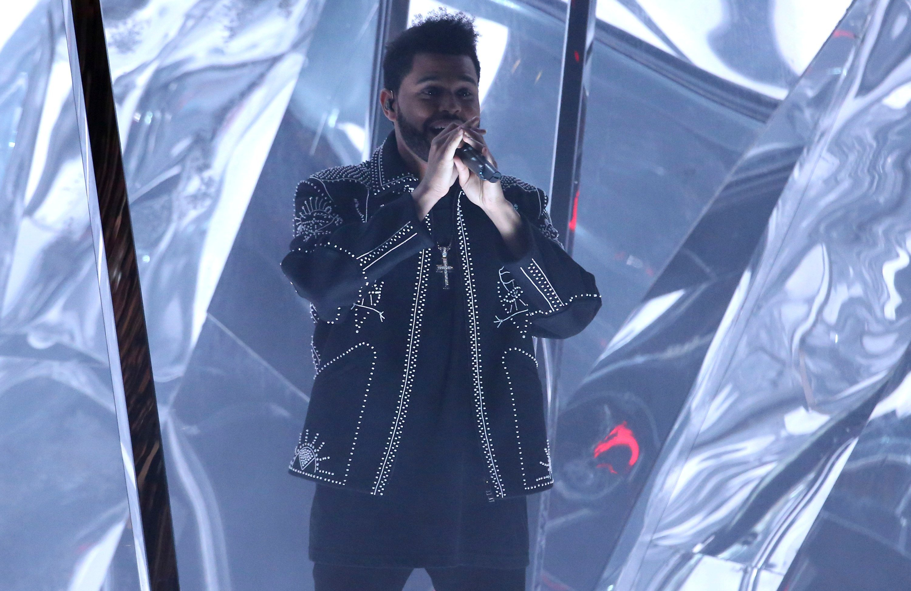"""The Weeknd performs """"Starboy"""" at the American Music Awards at the Microsoft Theater on Sunday, Nov. 20, 2016, in Los Angeles. (Photo by Matt Sayles/Invision/AP)"""