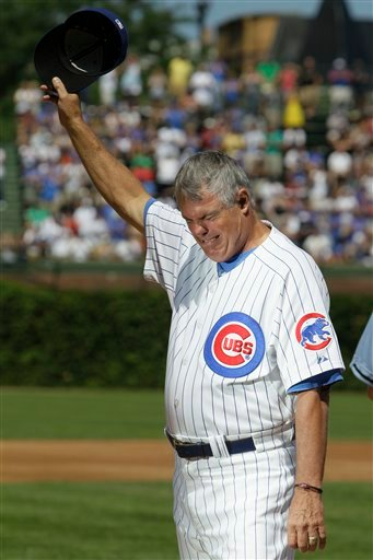 Chicago Cubs manager Lou Piniella reacts as he waves to the crowd before the start of a baseball game against the Atlanta Braves, Sunday, Aug. 22, 2010, in Chicago.