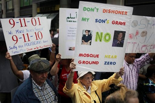 People participate in a rally against a proposed mosque and Islamic community center near ground zero in New York.