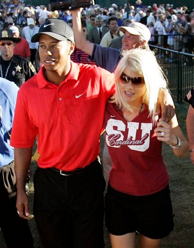 In this Aug. 20, 2006, file photo, Tiger Woods celebrates with wife Elin Nordegren after winning the 88th PGA Championship golf tournament at Medinah Country Club in Medinah, Ill.