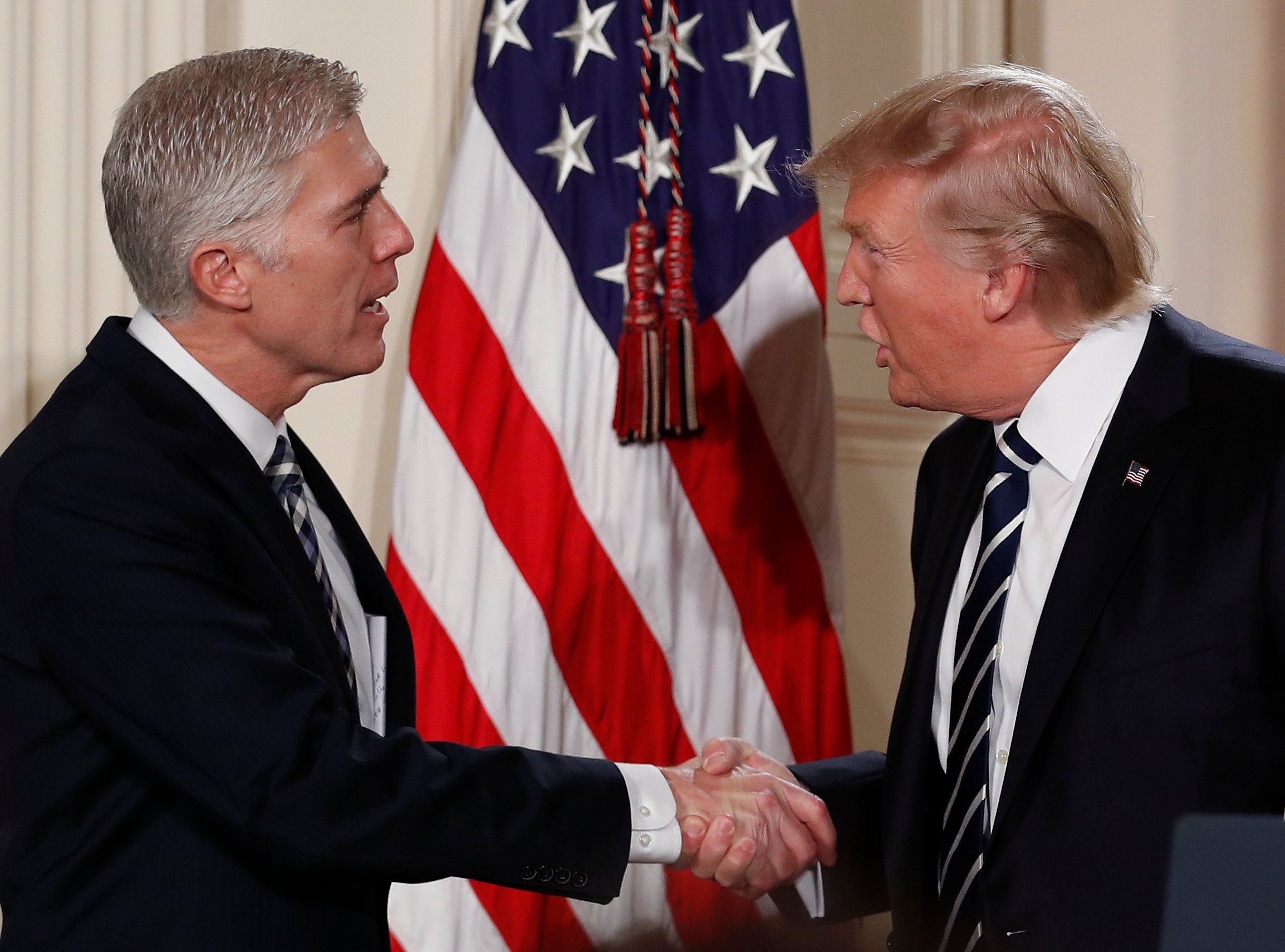 President Donald Trump shakes hands with Judge Neil Gorsuch in East Room of the White House in Washington, Tuesday, Jan. 31, 2017, as he announces Grouch as his nominee for the Supreme Court. (AP Photo/Carolyn Kaster)