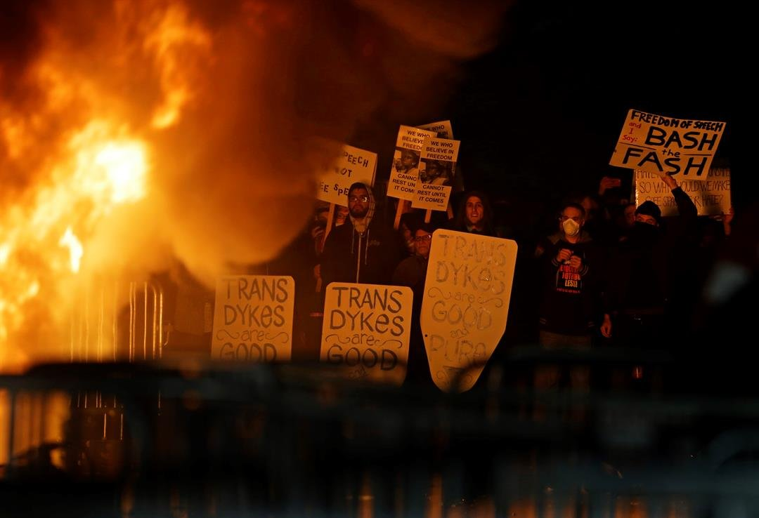 The event was canceled out of safety concerns after protesters hurled smoke bombs, broke windows and started a bonfire. (AP Photo/Ben Margot)