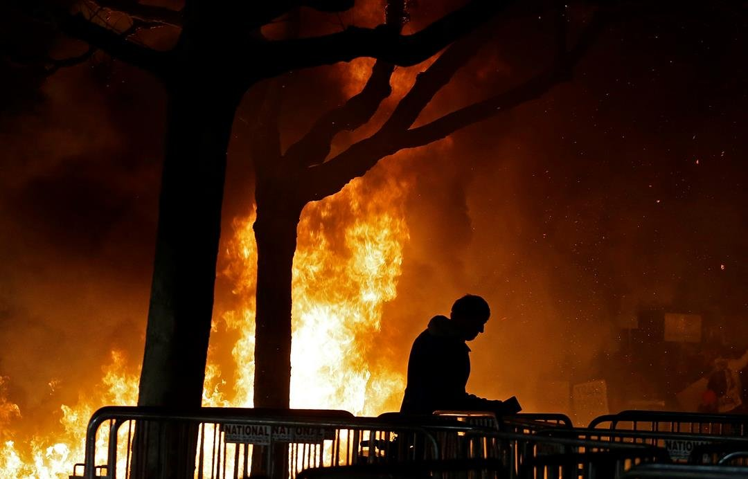 A bonfire set by demonstrators protesting a scheduled speaking appearance by Breitbart News editor Milo Yiannopoulos burns on Sproul Plaza on the University of California at Berkeley campus on Wednesday, Feb. 1, 2017, in Berkeley, Calif. (AP Photo/Ben Mar