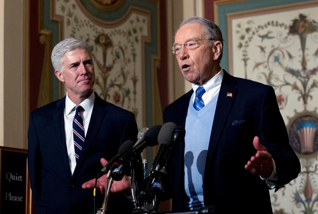 Supreme Court Justice nominee Neil Gorsuch listens at left as Senate Judiciary Committee Sen. Chuck Grassley, R-Iowa speaks on Capitol Hill in Washington, Wednesday, Feb. 1, 2017. (AP Photo/Jose Luis Magana)