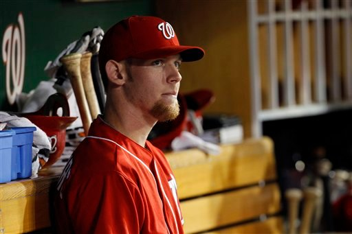 Washington Nationals pitcher Stephen Strasburg watches his team from the dugout during the seventh inning of a baseball game against the Arizona Diamondbacks in Washington, Friday, Aug. 13, 2010. (AP Photo/Ann Heisenfelt)
