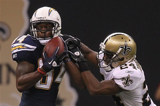 New Orleans Saints defender Leigh Torrence (24) tries to break up a pass to San Diego Charger receiver Buster Davis (84) in the second half of their preseason NFL football game in New Orleans Friday, Aug. 27, 2010. (AP Photo/Bill Haber)