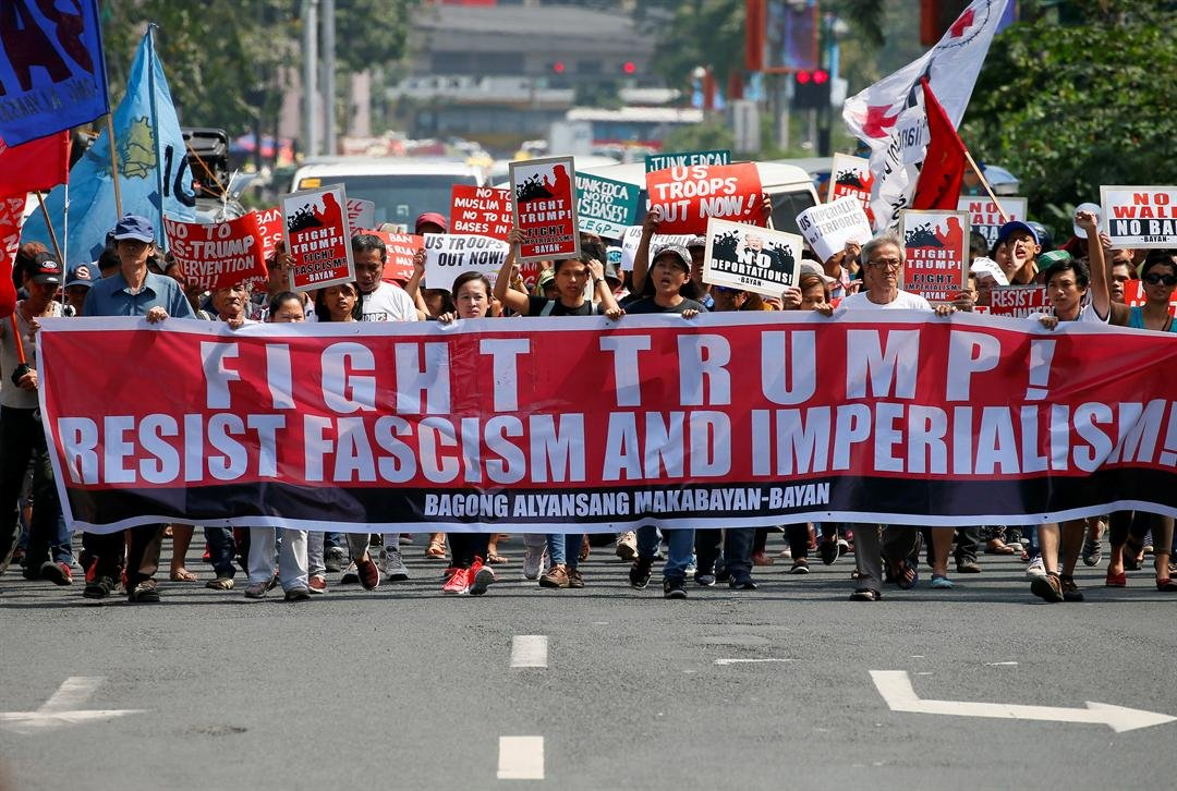 Prtoesters march with placards in front of the U.S. Embassy to protest U.S. President Donald Trump's recent anti-immigration policies, Saturday, Feb. 4, 2017, in Manila, Philippines. The protest also marked the Feb. 4, 1899 Filipino-American War. (AP Phot
