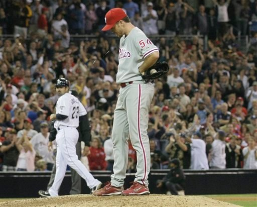 Philadelphia Phillies pitcher Brad Lidge reacts after being called on a balk as San Diego Padres' Adrian Gonzalez advances to third in the ninth inning during their baseball game Friday, Aug. 27, 2010 in San Diego.  (AP Photo/Gregory Bull)