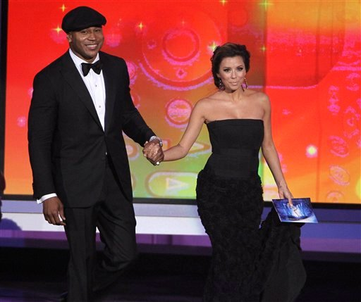Presenters LL Cool J, left, and Eva Longoria Parker take the stage during the 62nd Primetime Emmy Awards Sunday, Aug. 29, 2010, in Los Angeles.
