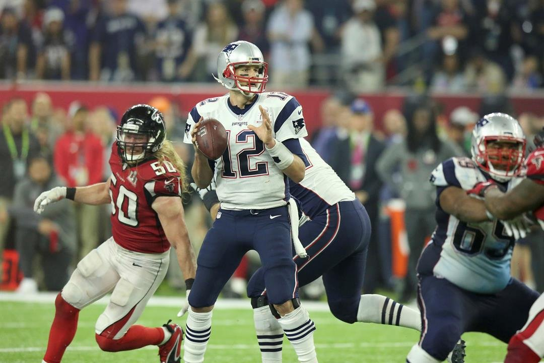 New England Patriots QB Tom Brady #12 throws a pass against the Atlanta Falcons in the NFL Super Bowl on Sunday, February 5, 2017 in Houston, TX. (AP Photo/Gregory Payan)