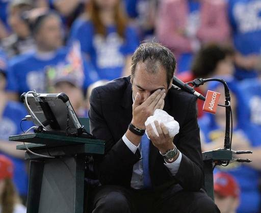 Umpire Arnaud Gabas, of France, holds his face after being hit by a ball during first-round Davis Cup tennis match action between Canada's Denis Shapovalov and Britain's Kyle Edmund, Sunday, Feb. 5, 2017.