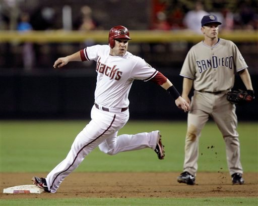 Arizona Diamondbacks' Miguel Montero looks back toward home as he takes second base in front of San Diego Padres second baseman David Eckstein in the second inning of a baseball game Aug. 31, 2010, in Phoenix. (AP Photo/Paul Connors)