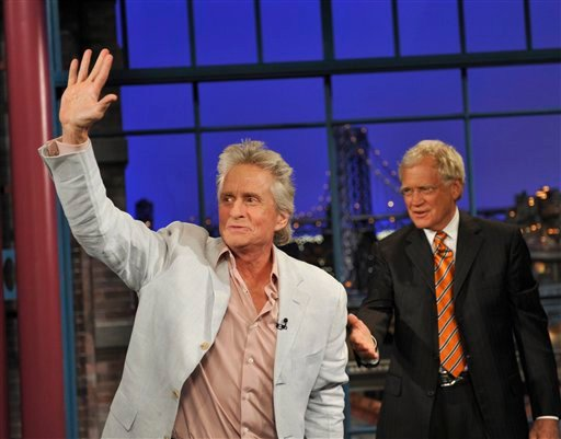 Photo provided by CBS, Michael Douglas waves to the Late Show audience after a hug from host David Letterman during the Tuesday, Aug. 31, 2010 taping of the show in New York. (AP Photo/CBS, John Paul Filo)