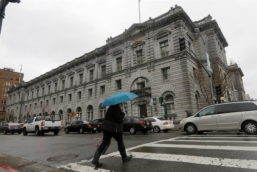 A woman crosses the street outside of the 9th U.S. Circuit Court of Appeals in San Francisco (AP Photo/Jeff Chiu)