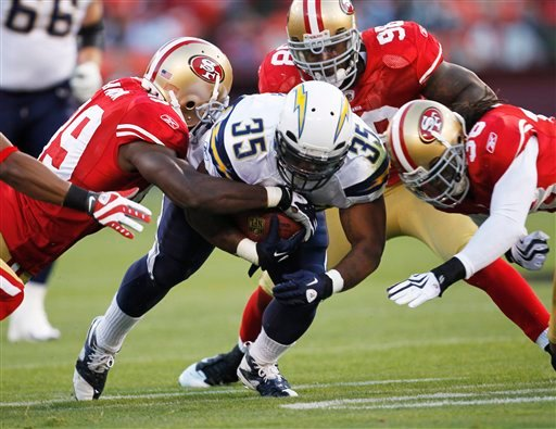 San Diego Chargers running back Mike Tolbert (35), rushes with the ball.