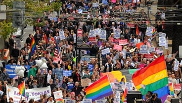 In this Wednesday, Aug. 4, 2010 file photo, hundreds of same-sex marriage supporters march through San Francisco. (AP Photo/Noah Berger, File)