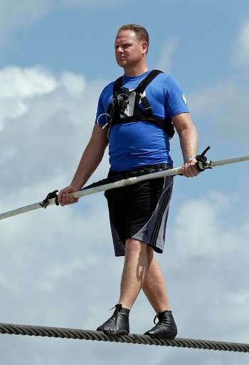 In this June 18, 2013 file photo, high wire performer Nik Wallenda practices in Sarasota, Fla.